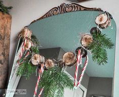 Cool and quirky fuzzy wood round and metal washer Christmas garland via http://www.funkyjunkinteriors.net/