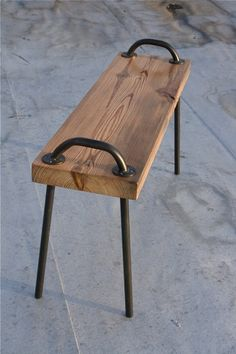 wald bench made from repurposed wood and steel pipes