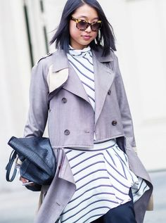A half zipped trench thrown over a striped dress.  // Photo: The Styleograph #Streetstyle #PFW