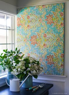 With a piece of bold fabric, you can create a striking piece of art in just about 10 minutes (and change it just as quickly whenever you feel like it). Get the tutorial at Lia Griffith »  - GoodHousekeeping.com
