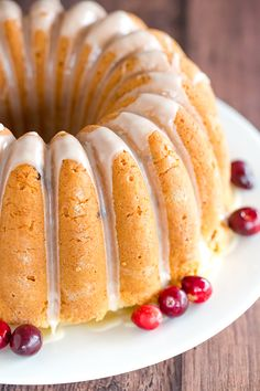 This Cranberry Pound Cake is wonderfully dense, moist and loaded with fresh cranberries. Topped with a simple orange glaze, it's perfect for the holidays.