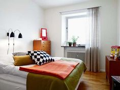 for vintage apartment style, LOVE the checkered pillow with plane white comforter
