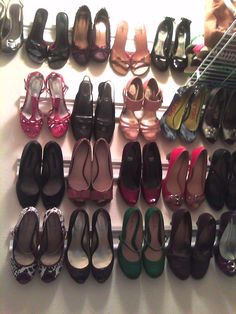 DIY creative shoe storage....i bought a 12' long piece of molding, Lowes cut it (for free) into four 3' pieces. i nailed then to the wall. You have to make sure the molding is appropriate for your average heel size (most of mine are 2 or 3 inches)...