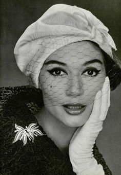 Simone D'Aillencourt wearing a hat by Lanvin-Castillo and brooch by Mauboussin, 1958. Photo: Philippe Pottier.