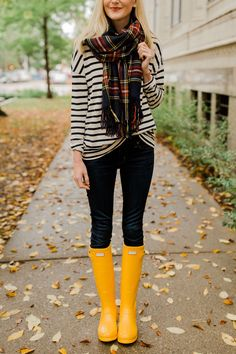 A few Fall outfit finds. Loving this Fall colored scarf, striped top, jeans, and the cutest yellow rain boots!