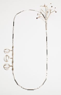 """Kristen Baird-""""As an artist, I design my jewelry to be elegant with a touch of personality and whimsy. I strive to create sculptural pieces that are unique in both form and concept. I enjoy using sterling silver with stones and glass for added splashes of color. """" U S A"""
