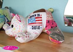 Stuffed animals made from old baby clothes- such a great alternative to a quilt!  Although I think I'd use a different toy design :P