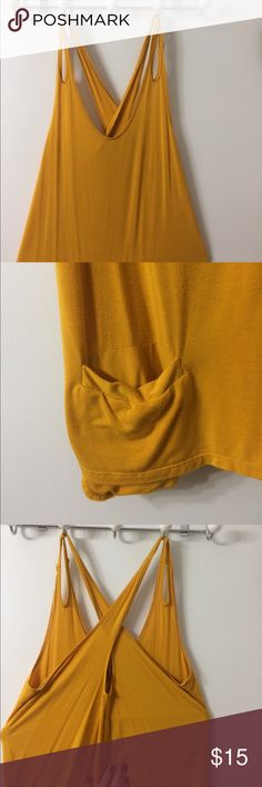 Peek a boo shoulder with cross back detail tank Peek a boo shoulder with cross back detail tank. Never worn. Mustard color, great for fall and winter under a chunky sweater. Dare Tops Tank Tops