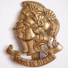 insignia of the ARTISTS RIFLES regiment, founded in 1860 in London as a  'Corps of Artists' -- painters, sculptors, engravers, musicians, architects, actors, and art students. They served with distinction in the Boer War and WWI. The cap badge, designed by Wyon, the Queen's medallist, consists of two heads: Mars - God of War, and Minerva - Goddess of Wisdom, was chosen to represent war and fine arts.