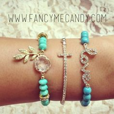 Turquoise bead bracelet with gold leaf charm, rhinestone cross bracelet, and turquoise bead love bracelet.