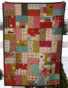 "easy, fast quilt!  ""I used a layer cake for the front. I cut each piece in half, sewed 2 together and then cut them to squares."""