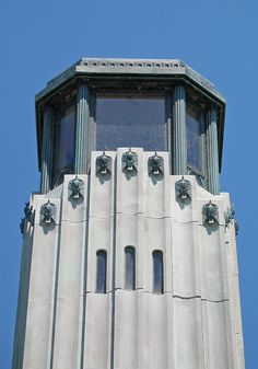 """William Livingstone Lighthouse, Detroit, Michigan This art deco lighthouse is located on the north end of Belle Isle, a large island in the Detroit River that was lanscaped by Frederick Law Olmstead. This image of the top shows the eagles that terminate each flute in the """"column"""" of the lighthouse."""