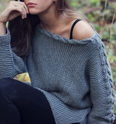 Knitting Pattern for Easy River Braid Sweater - This relaxed fit long-sleeved pullover is very easy according to the designer. It's knit in one piece sideways in garter stitch. Acontinuous double cable runs up the sleeve, and splits for shaping the neckline.