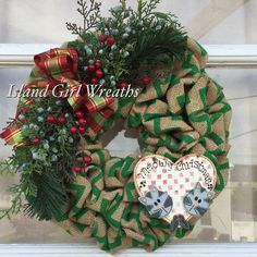 This is the perfect Christmas wreath for the true cat lovers! It's unique, handmade, one of a kind! Display your love for your purry friends with a little festive cat décor this holiday season!