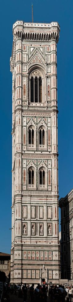 Giotto's Campanile is a free-standing campanile that is part of the complex of buildings that make up Florence Cathedral on the Piazza del Duomo in Florence, Italy.  Standing adjacent the Basilica of Santa Maria del Fiore and the Baptistry of St. John, the tower is one of the showpieces of the Florentine Gothic architecture with its design by Giotto, its rich sculptural decorations and the polychrome marble encrustations.  polygonal buttresses at the corners.[1]