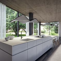 Going Full Concrete (v.): The act of designing your kitchen with concrete floors, ceilings, walls & Caesarstone Fresh Concrete kitchen island.