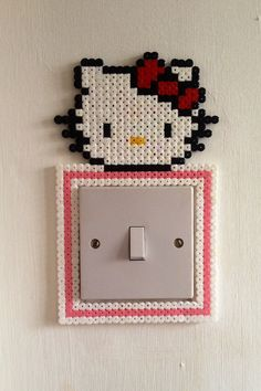 Hello Kitty light switch surround for children's bedroom perler beads by PlanetPixel