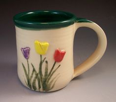 Brighten up your home with this Hand Made Pottery Tulip Mug/Ceramic Tulip Mug with Tulips. I first hand made the mug on the potters wheel, and