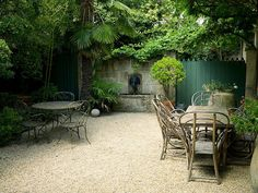 "Why not forget mowing a lawn? Convert a small yard to mostly ""patio"": lots of pebble w/ a few paver ""rugs"", edge w/ lots of green & punctuate w/ moveable potted greenery -- Designer Dominique La fourcade, one of Provence's best-known Country Garden Designers -- Clive Nichols garden photography"