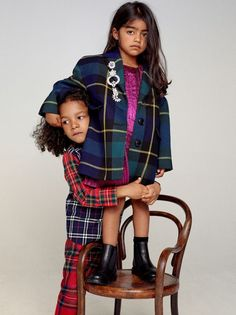Super cuter photo of girls wearing Burberry Mini Me Tartan Coats inspired by the Burberry Women's Fall WInter 2017-18 Collection.