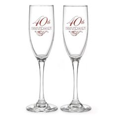 "40th Wedding Anniversary Toasting Flute Set includes two toasting flutes. They feature a classic flute design and shape with a thick and sturdy base, a thin stem, and a glass bowl on top in a traditional flute shape. The front of each flute is printed in red with the phrase ""40th Anniversary"" and a decorative flourish accent.  This item can be personalized."