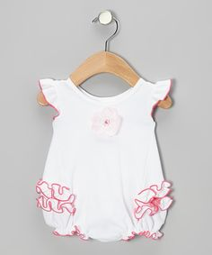 Boasting rows of ruffles, bottom snaps and a flower embellishment, this knit bodysuit fuses old-fashioned charm with a modern silhouette. Made in the USA from all-cotton construction means it's easy to clean this quality piece.100% cottonMachine wash; tumble dryMade in the USA