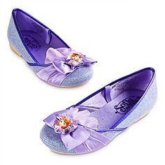 Disney Sofia Shoes for Girls   Disney StoreSofia Shoes for Girls - She can prepare to step into the role of being a princess with these Sofia Shoes for Girls. The shimmering purple uppers are decorated with a satin bow and faceted Sofia jewel so she will be the First to sparkle.