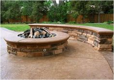 stone fire pit with stone bench | Sitting Benches . Benches provide a nice physical place to sit and ...