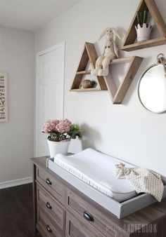 simple wooden triangle shelves for baby's nursery