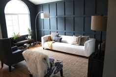 The couple wanted to make a dramatic statement in their then lavender living room...they bought the supplies and then did it themselves...see the transformation below.
