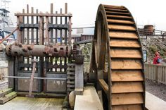 Geevor_waterwheel_stamps The restored 19th century waterwheel and tin stamps at Geevor Tin Mine, Cornwall, England. They were removed from Locke Farm, near Nancledra, in 1983.
