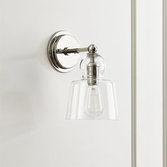 Lander Polished Nickel Sconce- crate and barrel. These will be perfect for the dining room