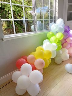 This rainbow balloon arch is awesome! Great For Party Decorations!