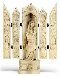 A FRENCH CARVED IVORY POLYPTYCH