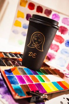Painted Travel coffee cup with logo dudyshkinaart.com. Paints palette. Art space of painter artist. #dudyshkina #workspace