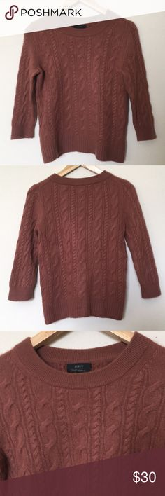 """J. Crew Cashmere Brown Cable Knit 3/4 Sweater PLEASE READ MEASUREMENTS!  I purchased this on eBay. The sweater is in good condition (minor pilling— see last 3 photos) but I suspect the previous owner shrunk it a bit in the wash as the fabric feels felted and it fits more like a J. Crew size small.  Otherwise it's a lovely rust brown 3/4 sleeve sweater with crew neck and cable knit pattern. Perfect for fall! 🍂   Approximate measurements (flat): Bust: 17"""" Length: 22.5"""" Shoulder: 13.5"""" Sleeve…"""