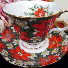 Stunning Royal Albert poinsettia Christmas tea cup and saucer