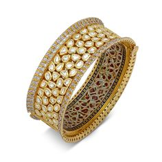 Luxury comes full circle in this magnificent bangle bracelet. Splendid Meenakari compliments an array of beautifully set Polki Diamonds in 22k yellow gold. This masterpiece is a testament to the imagination of Devam in creating the worlds finest custom jewelry.