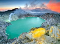 "Photograph by Hendra Gunawan, National Geographic Your Shot  Sulphur streaks the rocky, lake-filled Ijen crater in East Java, Indonesia. Your Shot member Hendra Gunawan captured this shot after climbing to the crater in the early hours of the morning. ""I went to the top,"" he says, ""and found a beauty I cannot write in words."""