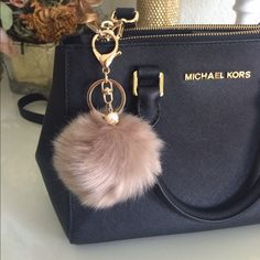 LAST ONE!! BEIGE POM POM KEYCHAIN!! Brand new!! Never used, faux rabbit fur keychain!! Comes with a Pearl attachment, along with a gold chain and gold clamp!! Fur is very soft. Super cute to hang on your purse or keys! Approx. hangs 4 inches and actual Pom Pom is 8cm. All sold Keychains will be bubble wrapped so you have to play with the fur to get its circular shape, or allow a day for the fur to settle itself! No trades. Purse is not for sale. This keychain has no brand. Accessories Key…