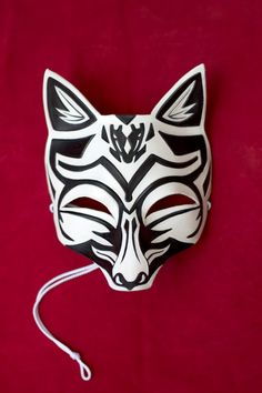 In stock and ready to ship!    This is a mask of a Japanese Kitsune (fox). Kitsune have been depicted in Japanese lore and are generally known