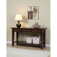 This refined modern console table has a versatile design that can be used in your entryway, hallway, living or dining room, or even a bedroom. Three drawers, a convenient lower shelf, and a beautiful walnut cherry finish set this solid piece apart.