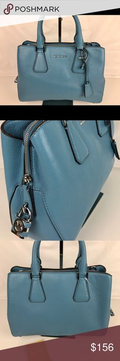 """Michael Kors Camille Sky Blue Medium Satchel Condition: New, without tags. A couple of very minor signs of handling on exterior and scuff mark on one handle. See photos.  Top zip and magnetic-snap closure. Top carry handles; optional, adjustable crossbody strap. Interior zip, wall and smartphone pockets; key clip. 11.25""""L x 4.75""""W x 8.75""""H; 4.5"""" handle drop, 22.5"""" to 24.5"""" strap drop. Style 30H5SCAS2L. Our bag # RB345  Thank you for your interest!   PLEASE - NO TRADES / NO LOW BALL OFFERS…"""