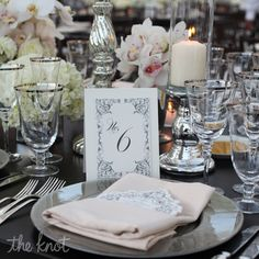 candles and orchids centerpiece