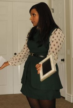 Mindy Kaling's green dress on The Mindy Project  layer black peplum dress over green loft blouse or white tahari blouse