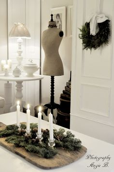 I know that it is far from Christmas, but I love this vintage cutting board with candles as a centerpiece.  You could substitute the evergreens with something that fit the current season/holiday.