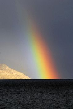 ✮ A bright rainbow ends off of Squally Point, Okanagan Lake, shot from Peachland, British Columbia