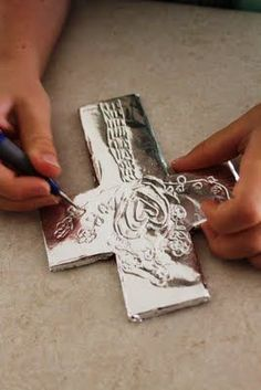 Mumma made it: Good Friday cross craft - foil, foam, wooden embossing (could use a non-pointy toothpick or a Q-tip with the cotton cut off maybe-Do it with the glue and then cover with tin foil maybe with glaze stain ? Catholic Crafts, Catholic Kids, Church Crafts, Kids Church, Church Camp, Church Ideas, Bible School Crafts, Sunday School Crafts, Bible Crafts