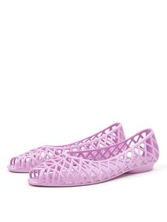 b554efed074c A lightweight jelly sandal featuring a latticework pattern and half inch  heel. If you wear a half size