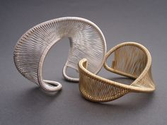 """Cuffs   Tana Acton.  Each piece is created from a single """"thread"""" of sterling silver, 12k gold-filled, or copper."""